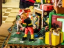Detail f an elf preparing a gift on the O Christmas Tree gingerbread village, 2014 Holiay Season in Seattle.