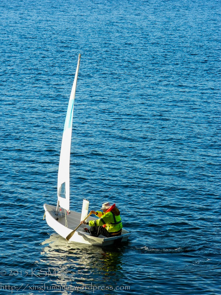 Rowing the sailing dinghy.