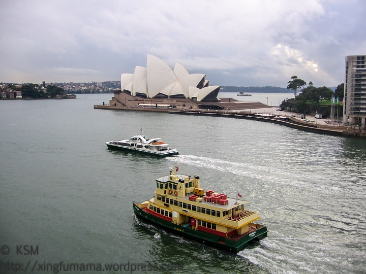 Two ferries heading out of Sydney Australia, Opera House i the background.