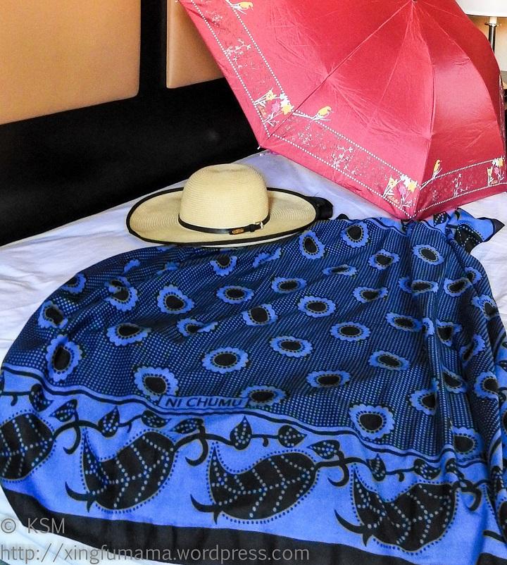 Khanga, sun hat and sun umbrella.