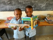 "Two boys reading books carried by ""Bertha"""