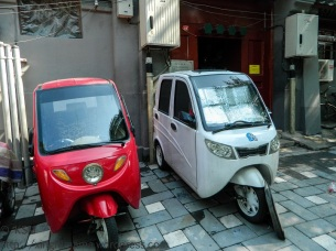 Interesting vehicles parked on a sidewalk in Beijing China