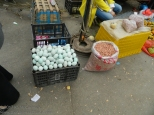 Raw eggs, possibly duck or goose, for sale at a street market.