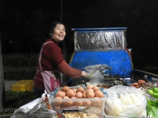 Eggs used to make fresh egg rolls on an evening food street by a factory in Weifang.
