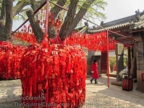 Worshiper at a shrine to the Goddess of Heaven, Tian Hou.