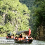 Tourist sampans heading upstream.