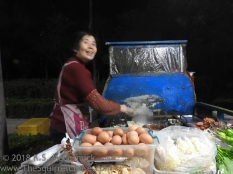 Street vendor's suply of eggs for fresh cooked meals.