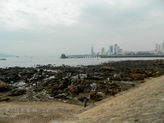 Gatheing seafood on Qingdao beach.