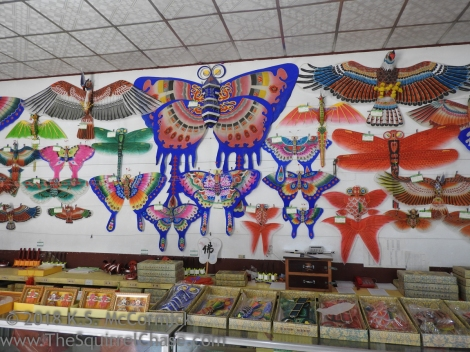 Display of several traditional kite designs.