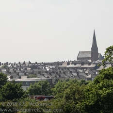 Church poking up over and ocean of roof tops in Barrow-in-Furness.