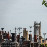 Chimney pots and antenna on York roofs.
