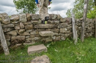 Stile built into a stone wall.
