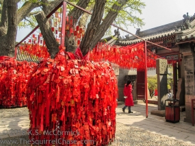 Red prayer ribbons at Tian Hao Temple in Qingdao, China.