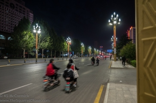 Well lit main streets make it safer for the scooters, who rarely if ever use headlights.