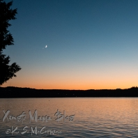 Venus and the waxing moon, near moonset over the Kitsap Peninsula.