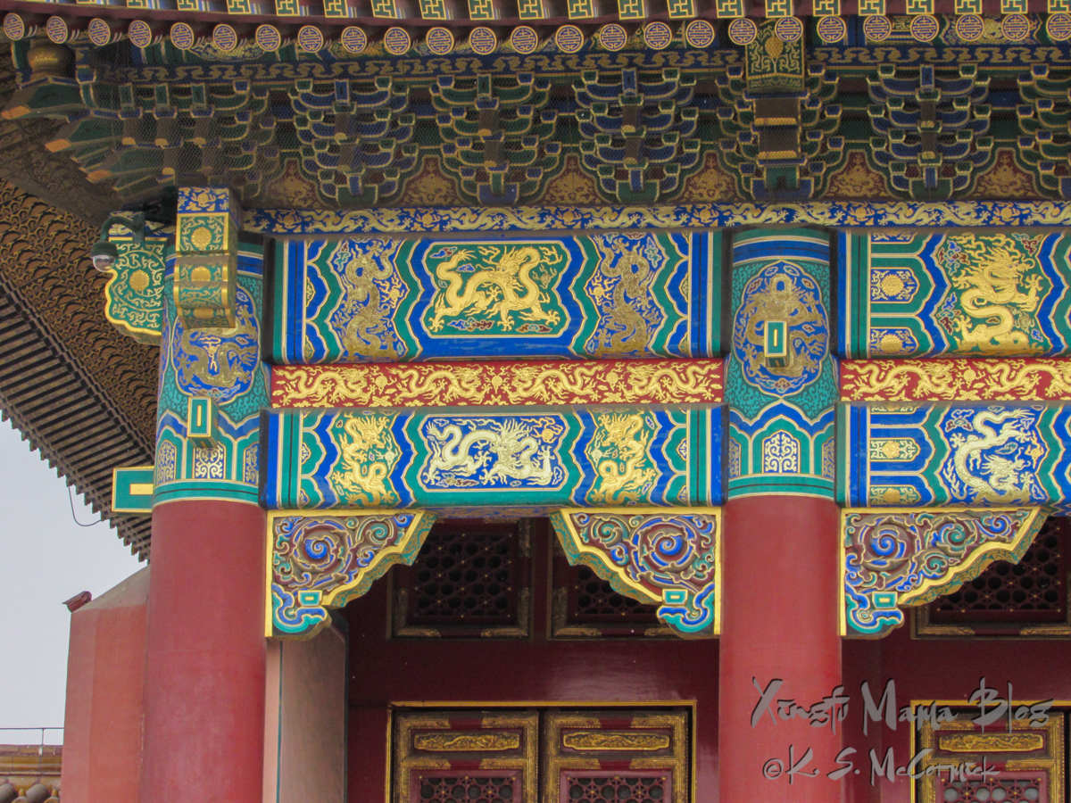 The intricately painted support beams and soffits of the Hall of Supreme Harmony, Forbidden City, Beijing, China.