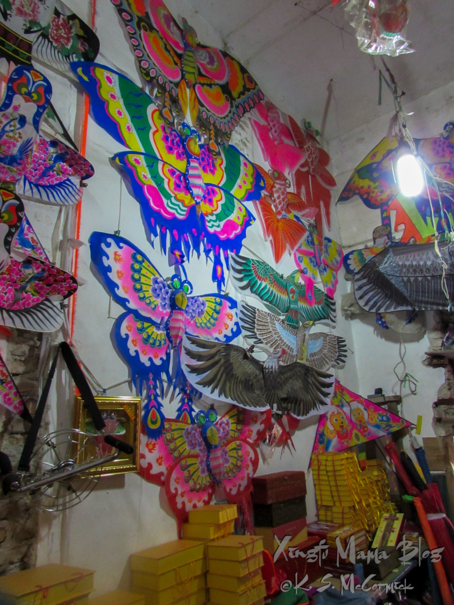 Brightly painted butterfly, bird and fish paper over bamboo frame kites in Weifang, China.