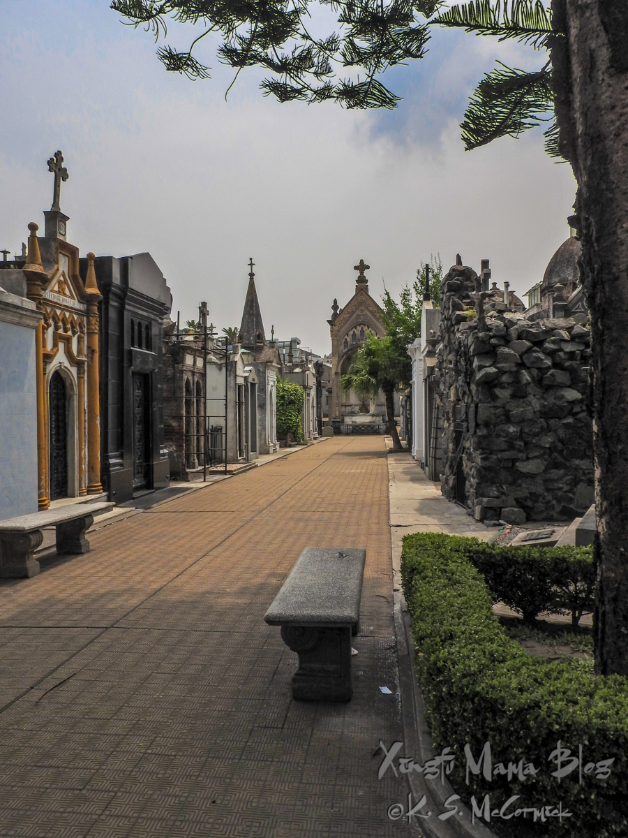 Benches in front of mausoleums at Recoleta Cemetery in Buenos Aires.