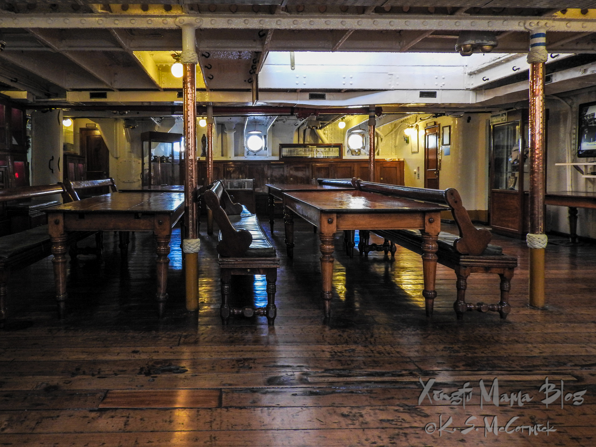 Wooden tables and benches of a dining hall on the Museum ship Fragata Sarmiento in Buenos Aires.