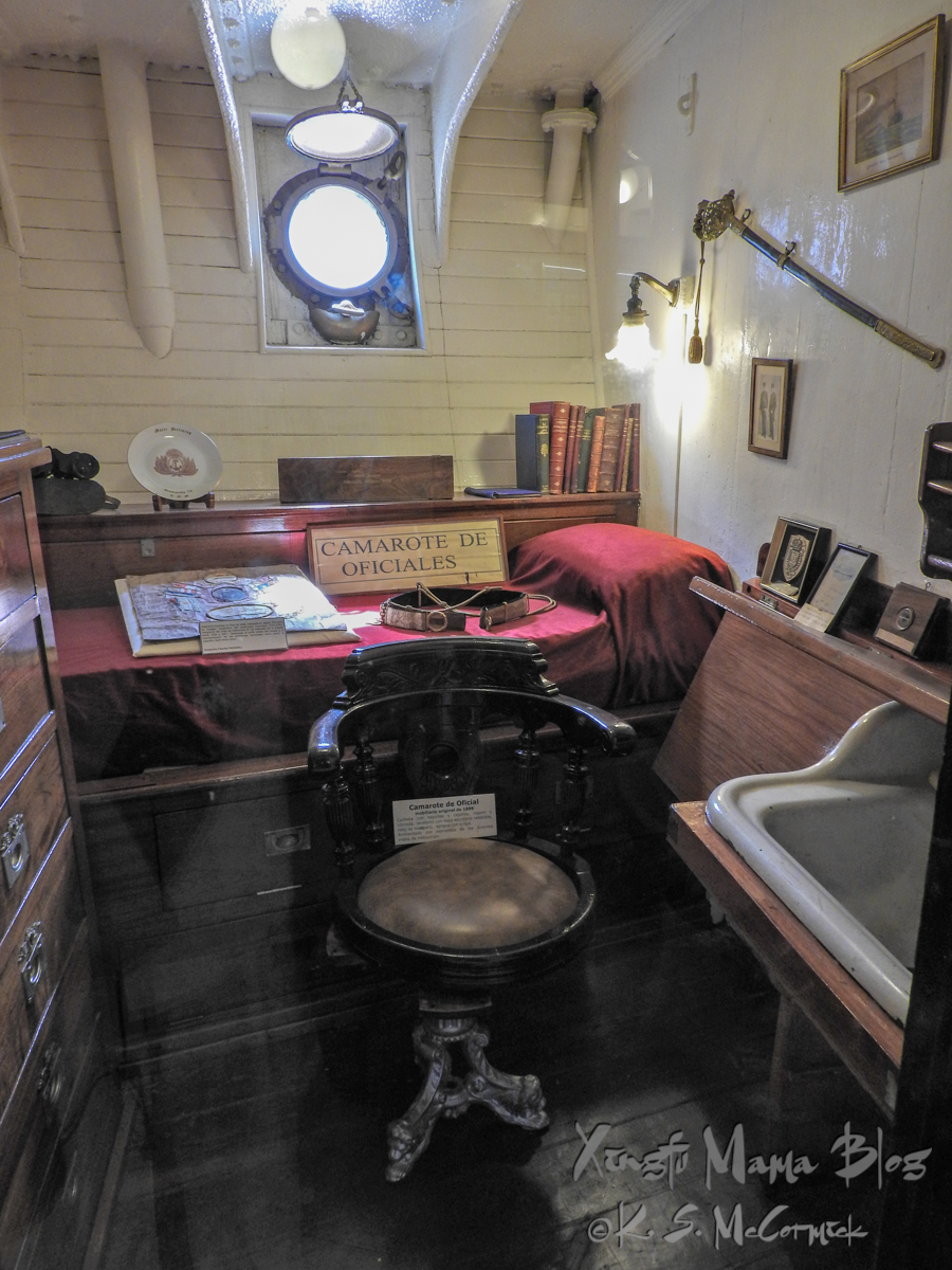 Bed, chair and other furnishings in an officer's room on the museum ship Fragata Sarmiento in Buenos Aires.