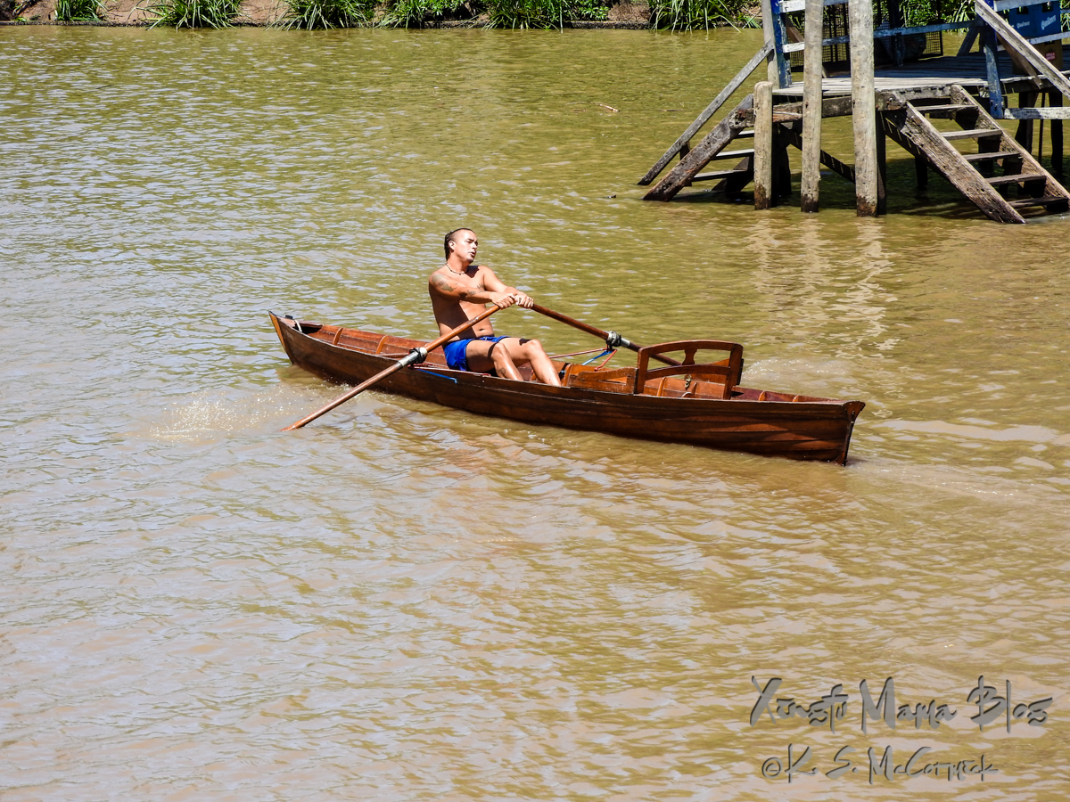 Rower with a beautiful wooden shell in the Parana Delta.