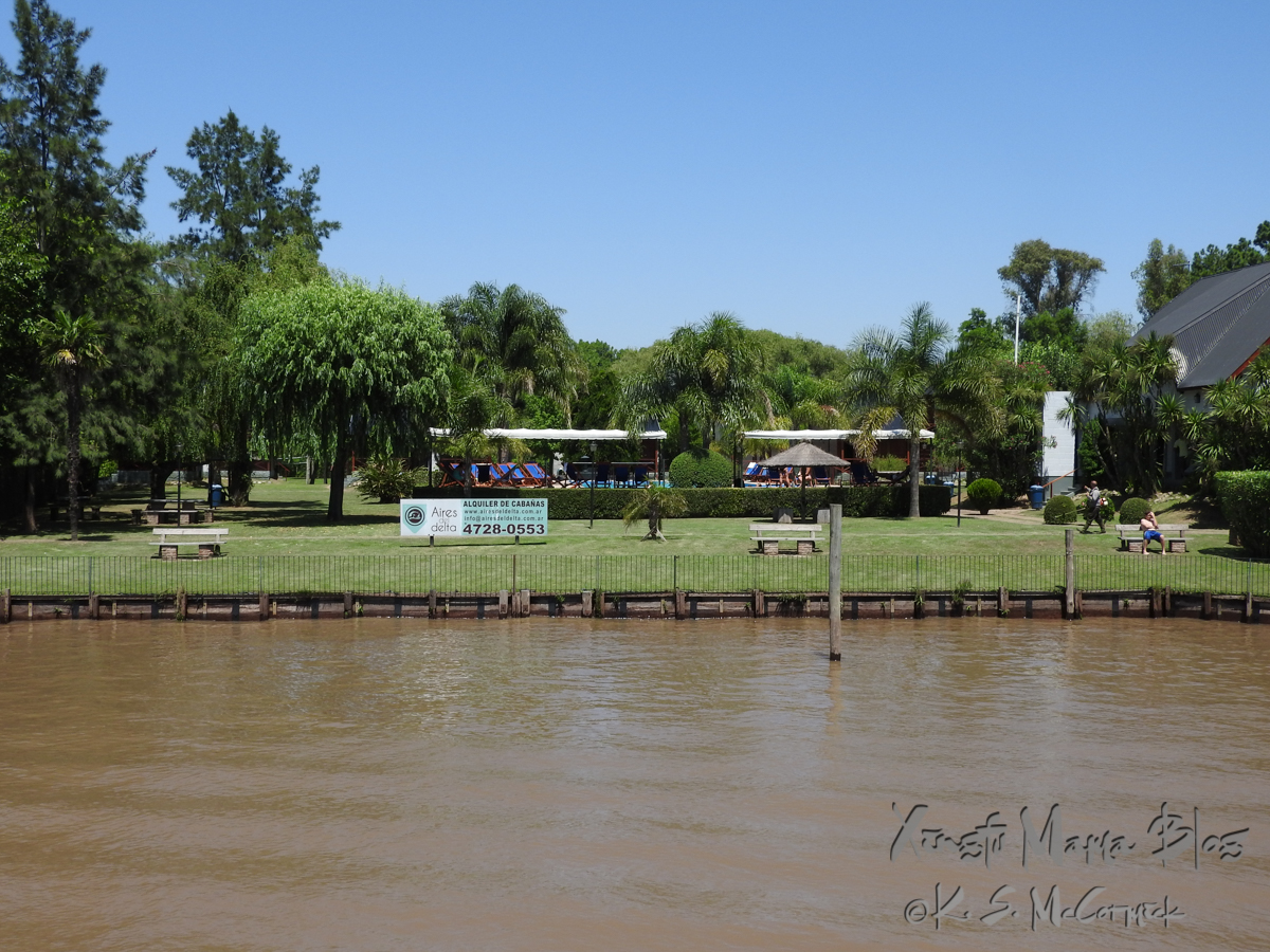 Resort with benches facing the water ways in the Parana Delta.