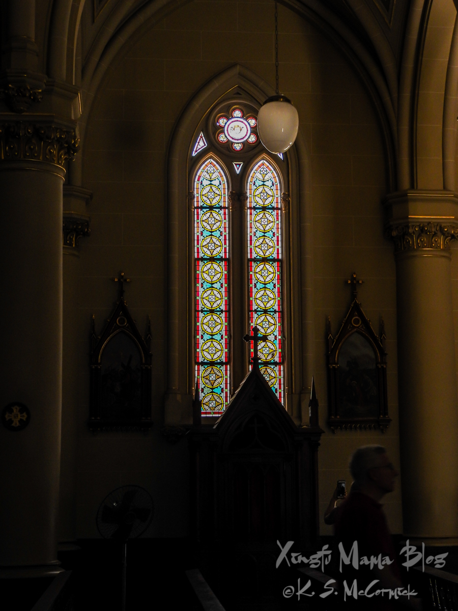 Man sitting in the dark cathedral of San Isidro, in the suburbs of Buenos Aires, Argentina.