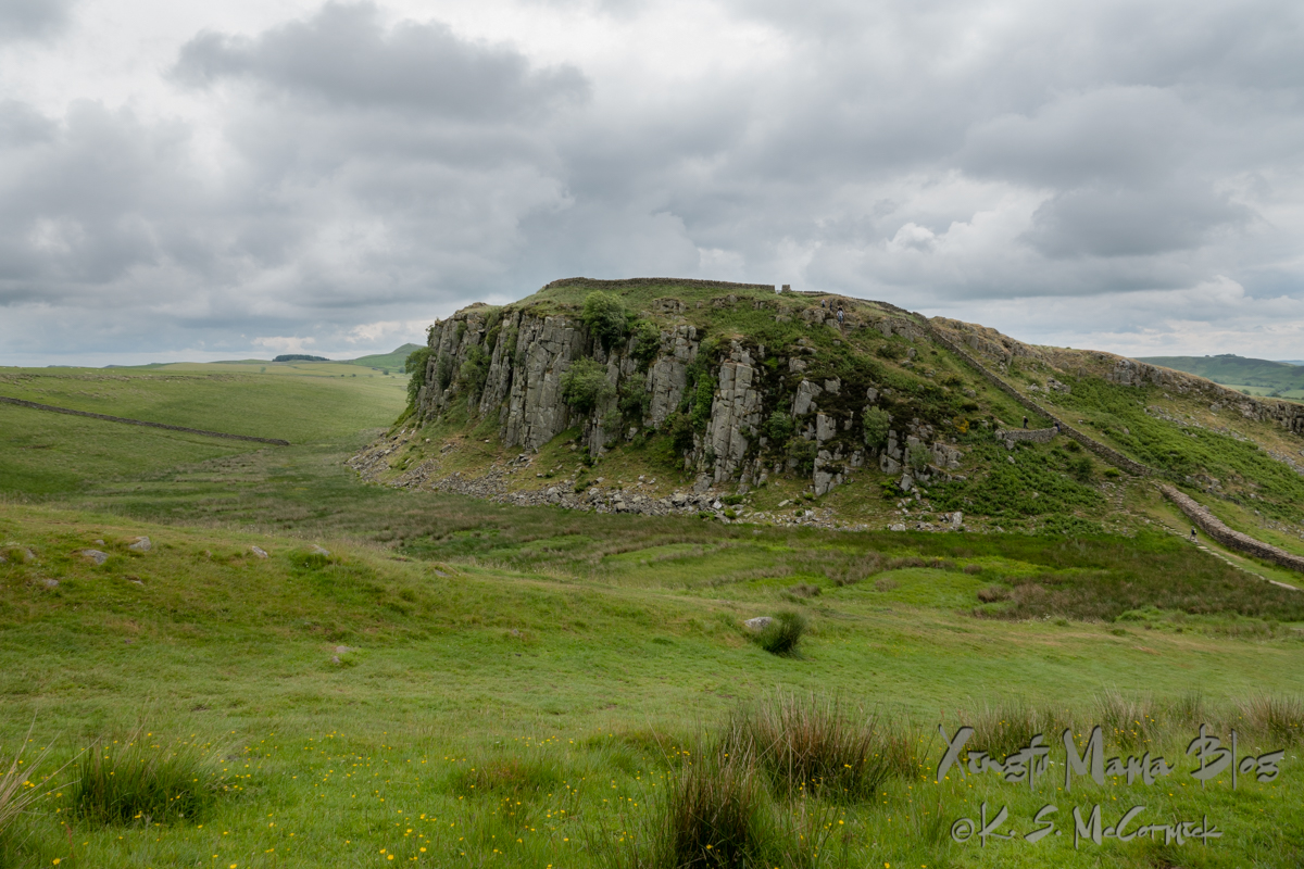 Steel Rigg geological formation has a gradual rise from the south and sheer cliffs on its north side. Hadrian's wall ran along the top of the cliffs.