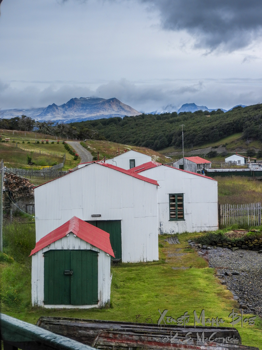 Out buildings of Estancia Habrerton and the start of the Pan American Highway with the mountains of Tierra del Fuego in the background.