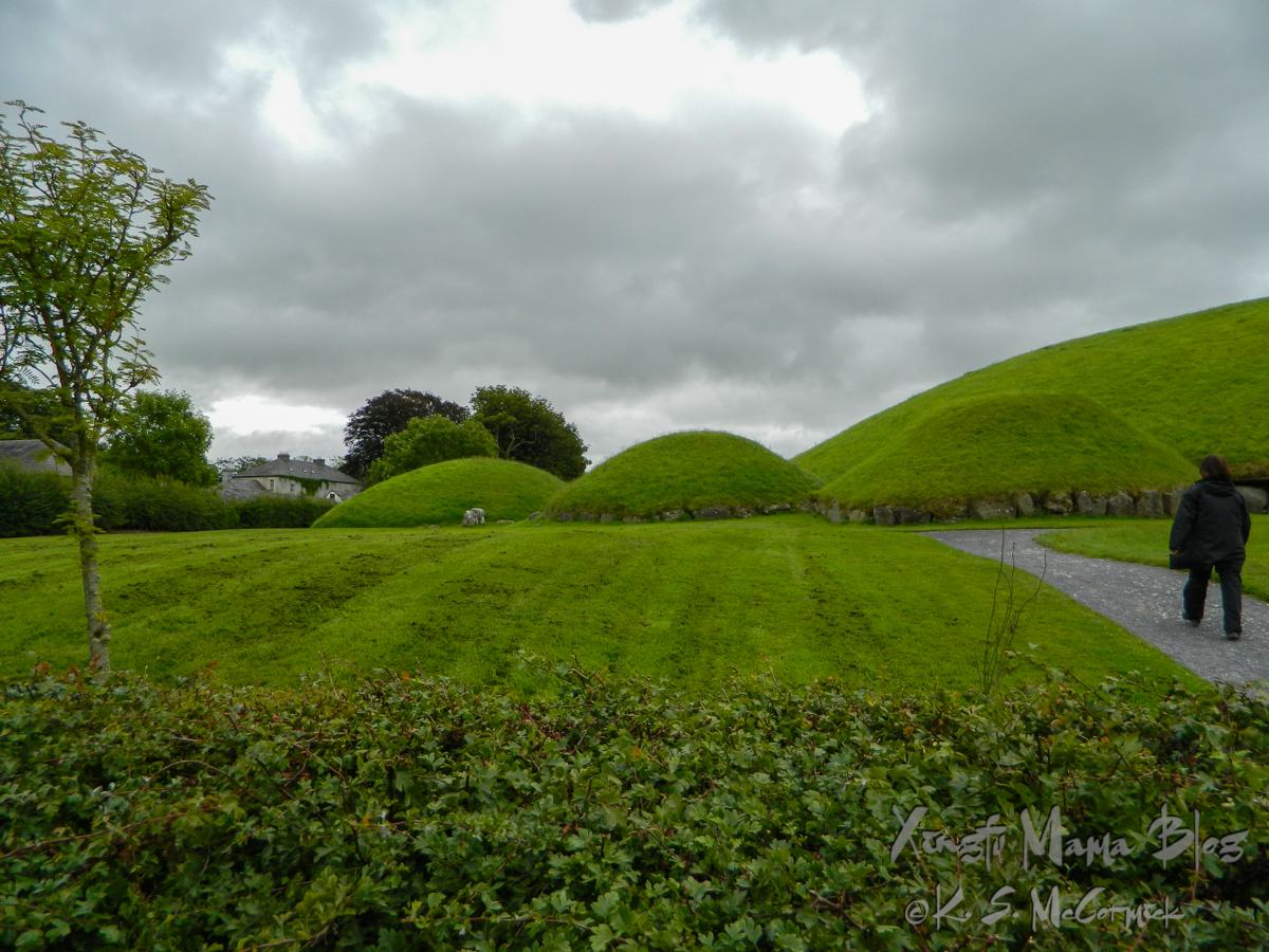 Three smaller burial mounds sit beside a large mound at Knowth, Bru na Boinne, in County Meath Ireland.