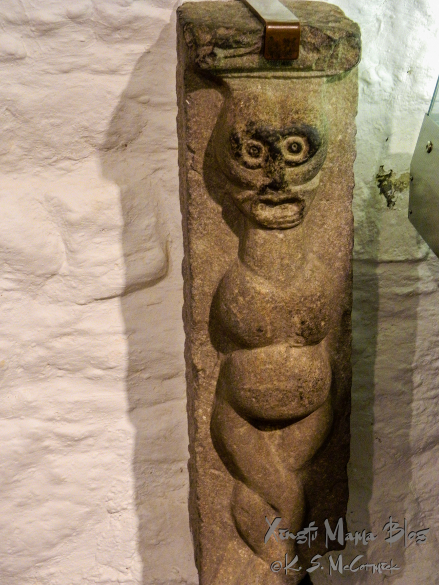 Ancient stone carving of a pregnant woman. St the Rock of Cashel in Ireland.