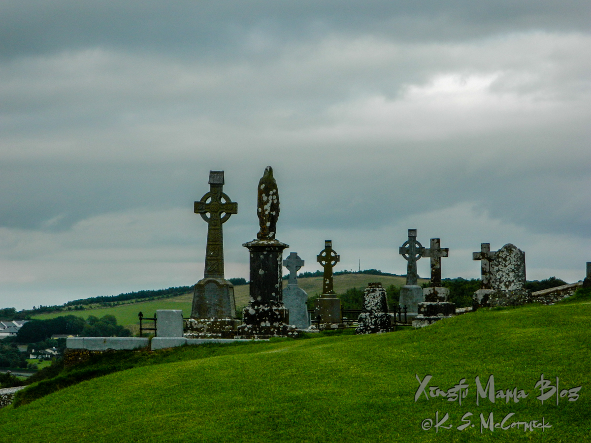 Several stone crosses of different styles and ages mark graves in the burial ground at the Rock of Cashel in Ireland.