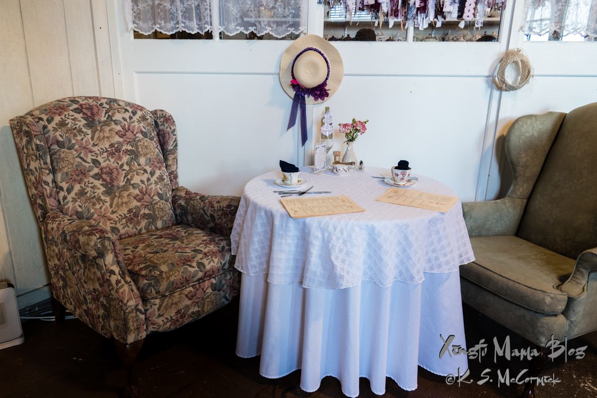 Two wing chairs at a table in the tea room-our table.