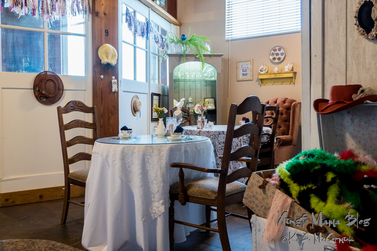 Tables and chairs ready for customers, and a chest of dress up clothes for younger customers at the tea rooms in the Grainery building in Mount Vernon, Washington State.