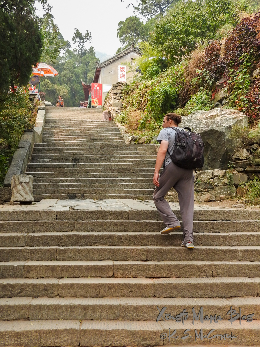 Man climbing stone stairs.