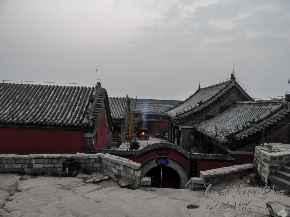 As evening falls a fire burns in the courtyard of the Confucius Temple at the top of Mount Tai (aka Taishan) in Shandong Province, China.