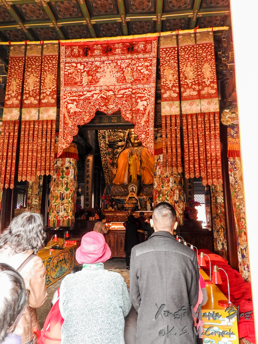 Worshipers at the giant Buddha in the Lama Temple in Beijing.
