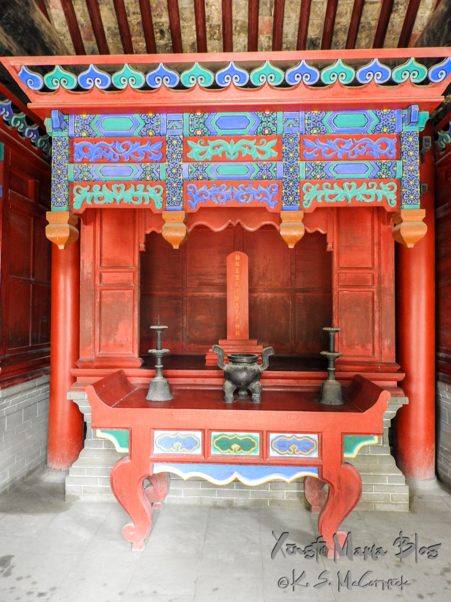 Red altar decorated with blue painting, the focus is a tablet. at Kong Miao (Confucius Temple) in Qufu, SHandong Province, China.