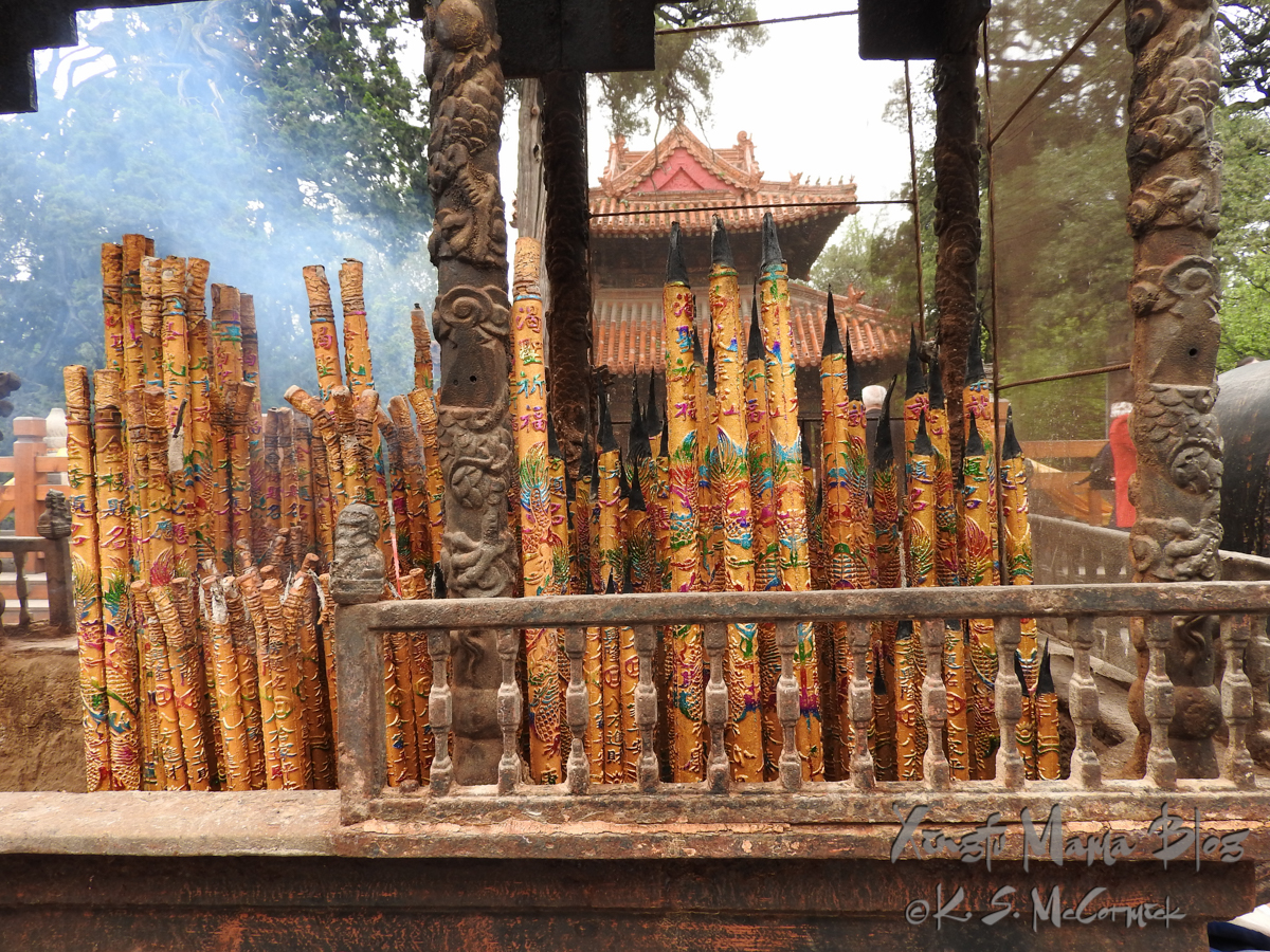 Rows of large, ornately painted sticks of incense, on a decorated altar at Kong Miao (Confucius Temple) in Qufu, Shandong Province, China.