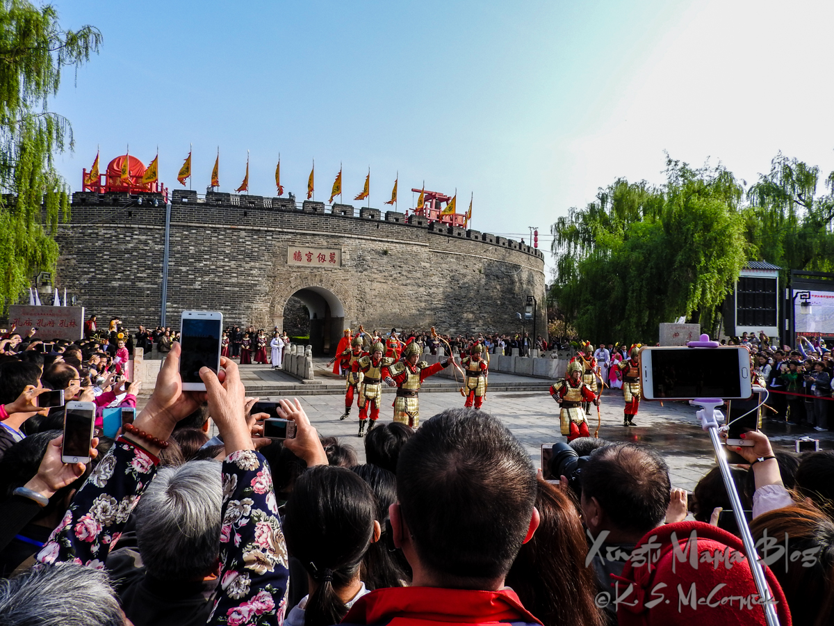 Crowds watching the opening ceremony of the old part of the city, Qufu, Shandong Province, China.