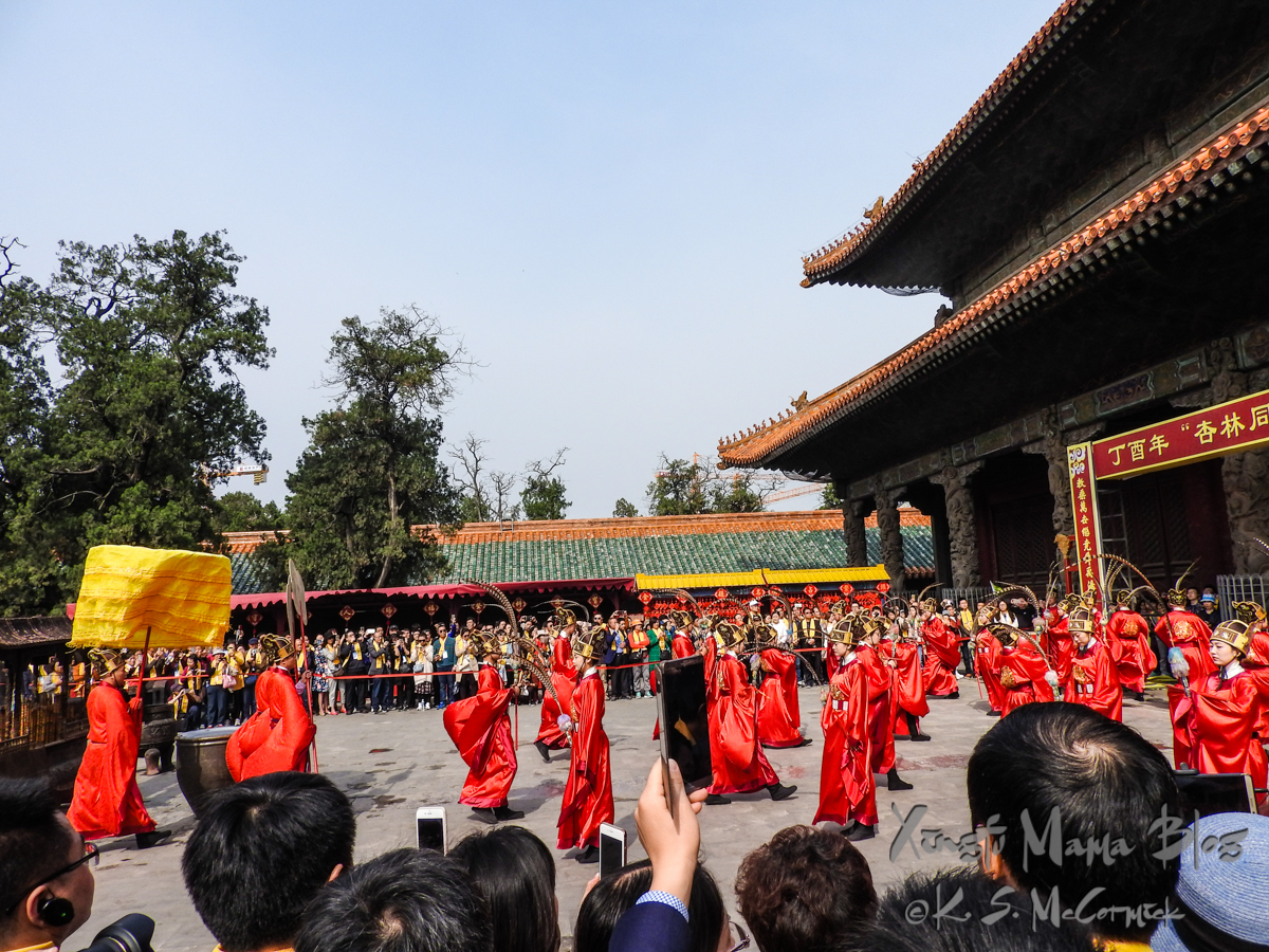 Crowds watching a reenactment of a ceremony at the Kong Miao (Confucius Temple).