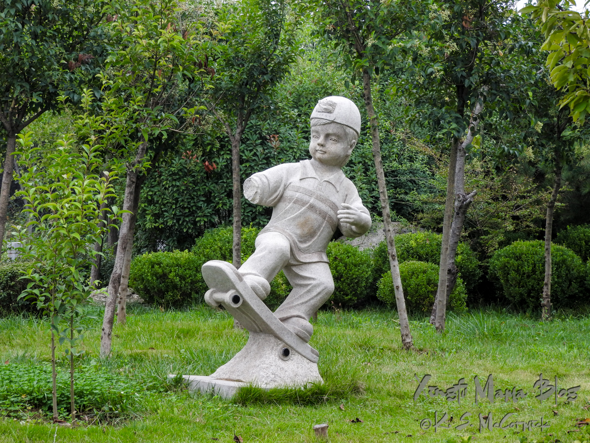 Granite sculpture of a boy skateboarding.