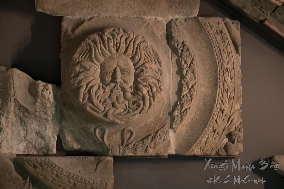 Roman stone carvings at the Roman Baths in Bath, England.