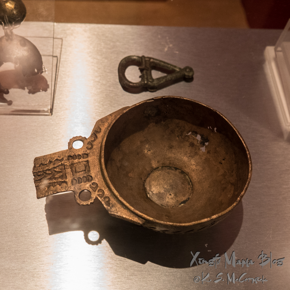 A small pot or eating dish found at Bath, that was from a soldier stationed on Hadrian's Wall.