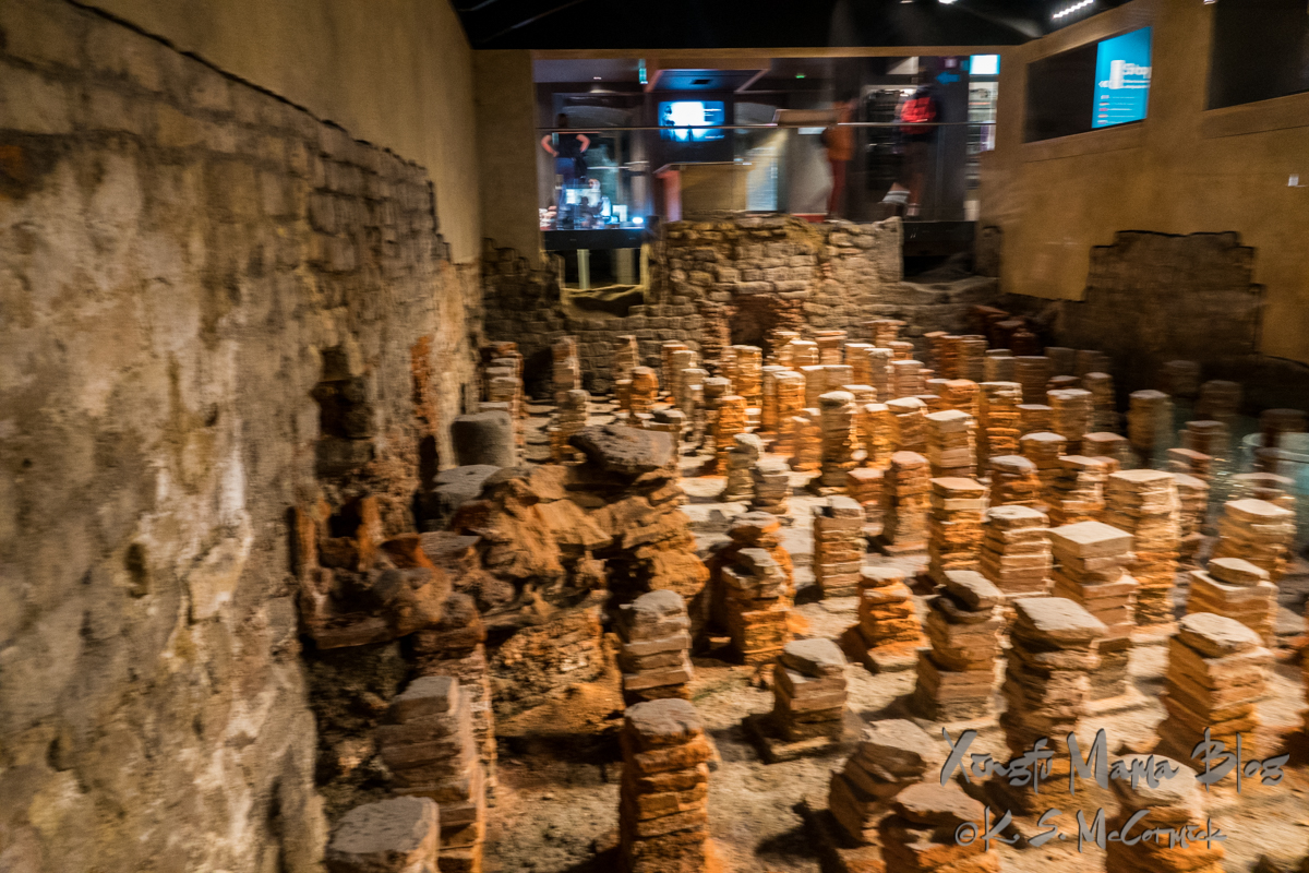 Stone piles that supported the heated floors in one of the therapy rooms at the Roman Baths in Bath England.