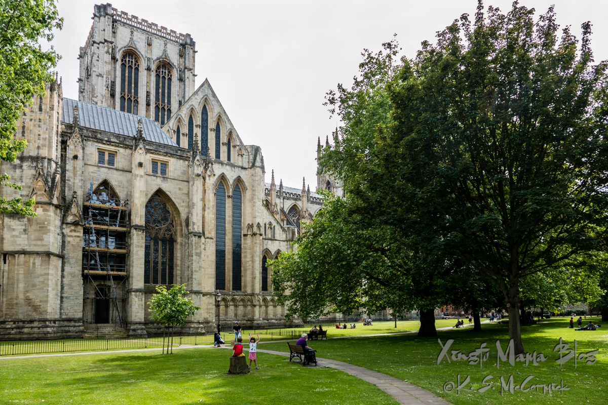 People enjoying the grounds of York Minster on a beautiful summer day.