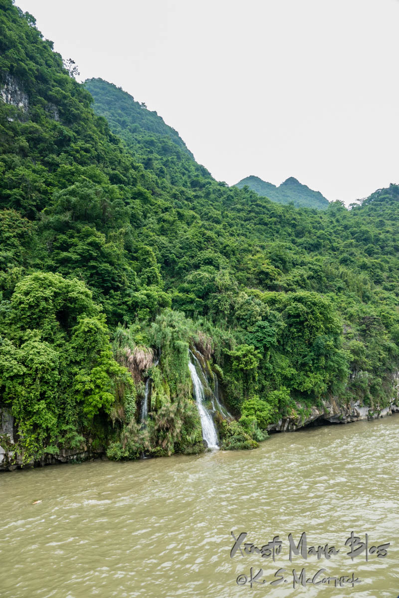 Waterfall among the verdant scenery on the banks of the Li River in Guilin, China.