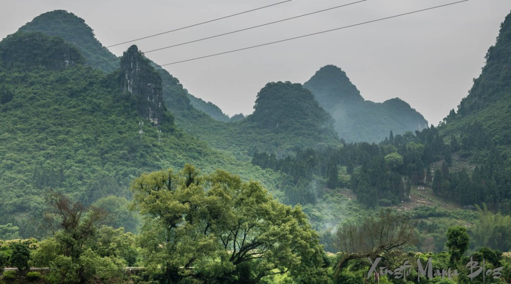 Karst hills, a little misty, are covered with verdant vegetation. Guilin, China.