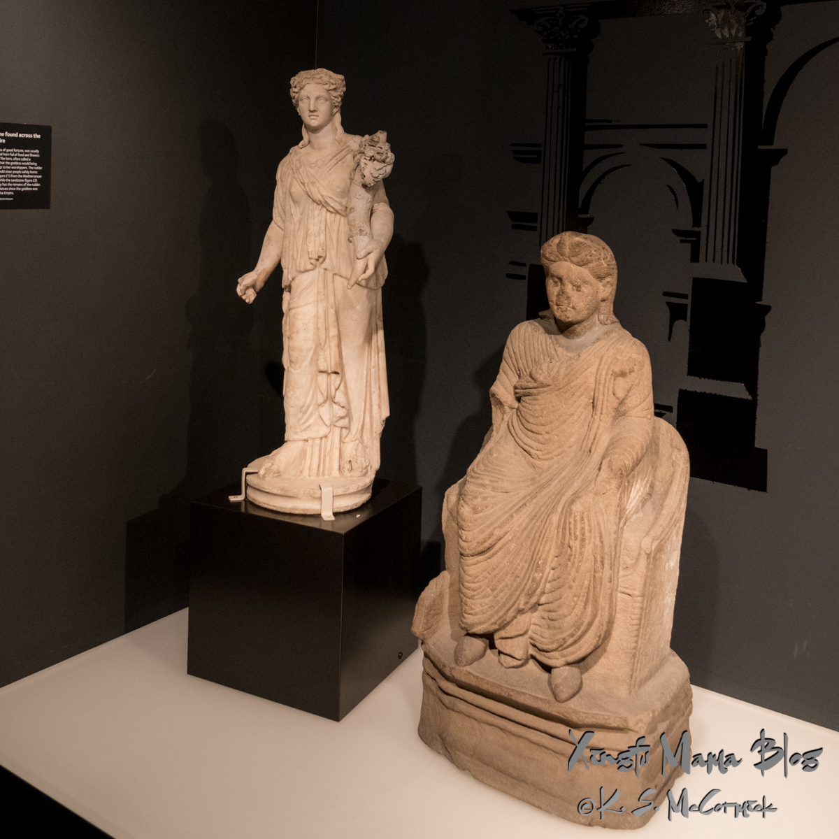 Two Roman era stone carvings of Minerva, a marble one from Rome and a sandstone one made in Cumbria during the Roman occupation. At Tullie House Museum, Carlisle, Cumbria, England.
