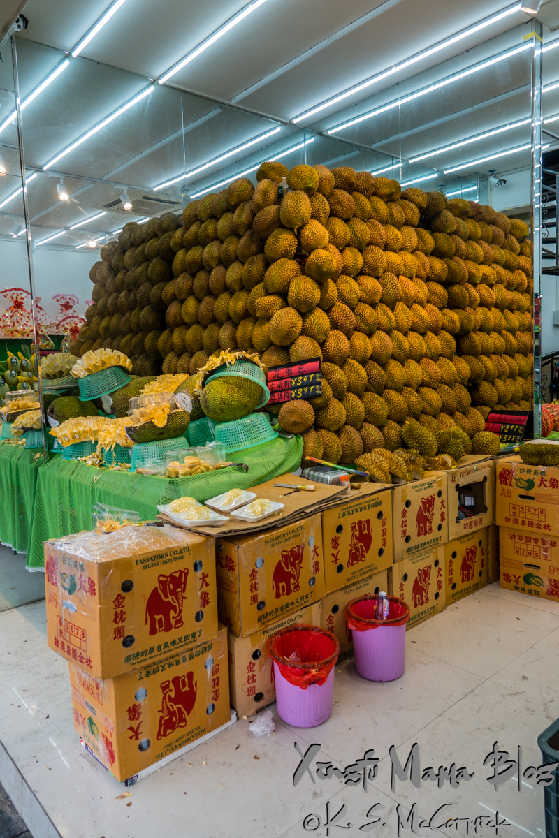 Many, many durian piled high for sale in Guilin, China.